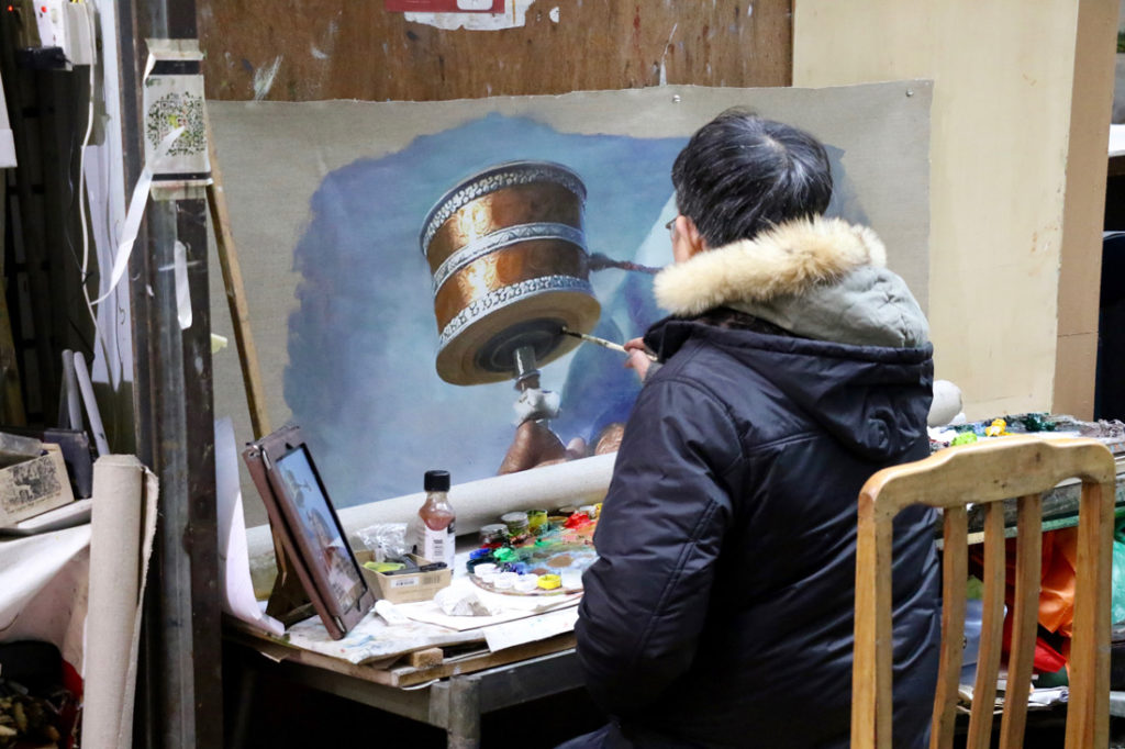 Artist making a copy from a photo